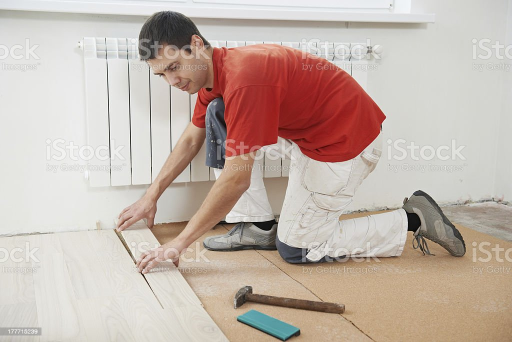 Carpenter Worker Joining Parket Floor Stock Photo More Pictures Of