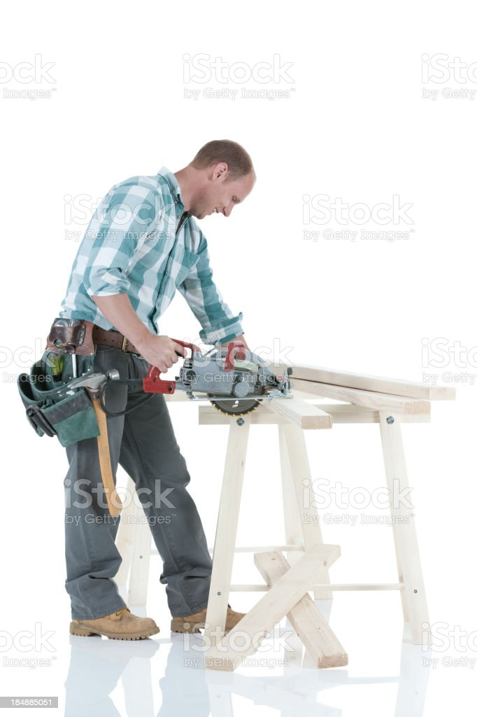 Carpenter working in a workshop stock photo