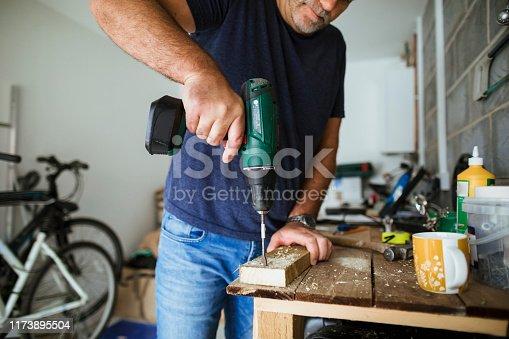 istock Carpenter Working in Workshop 1173895504