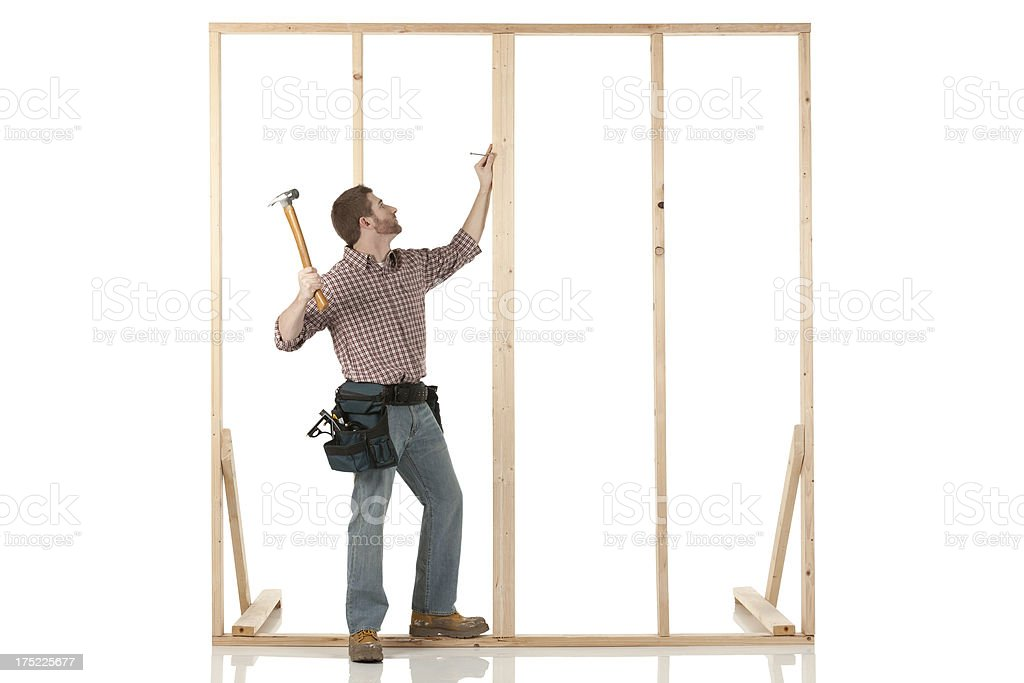 Carpenter working on a frame royalty-free stock photo