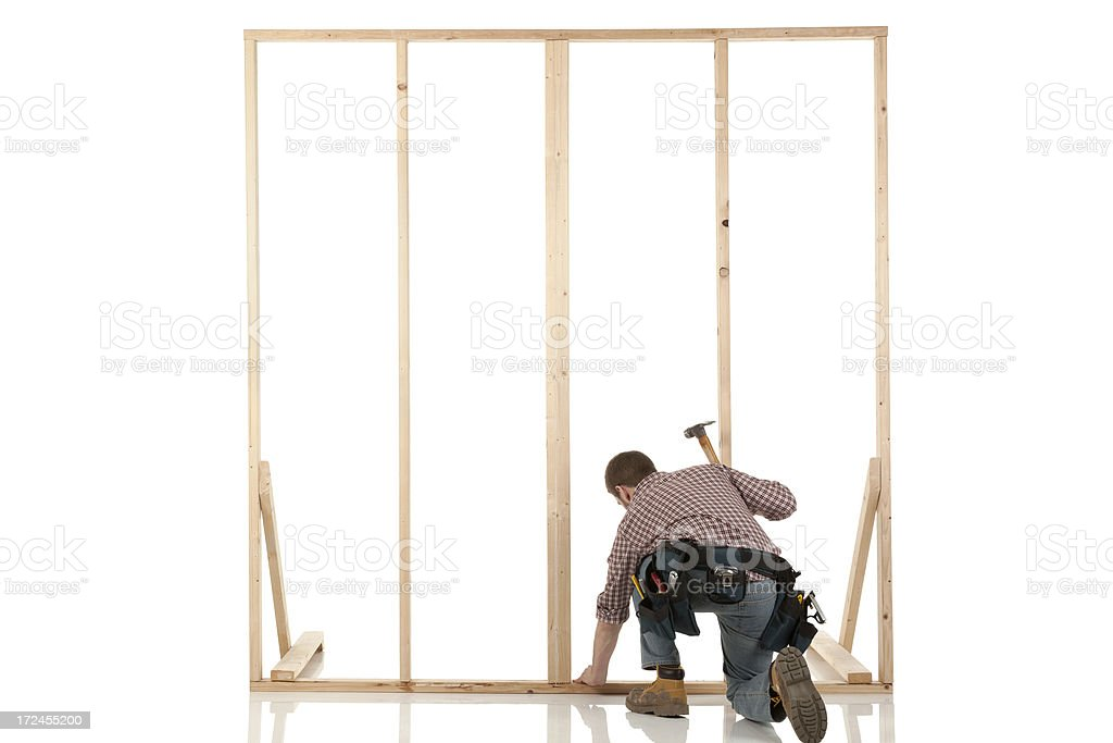 Carpenter working on a wooden frame royalty-free stock photo
