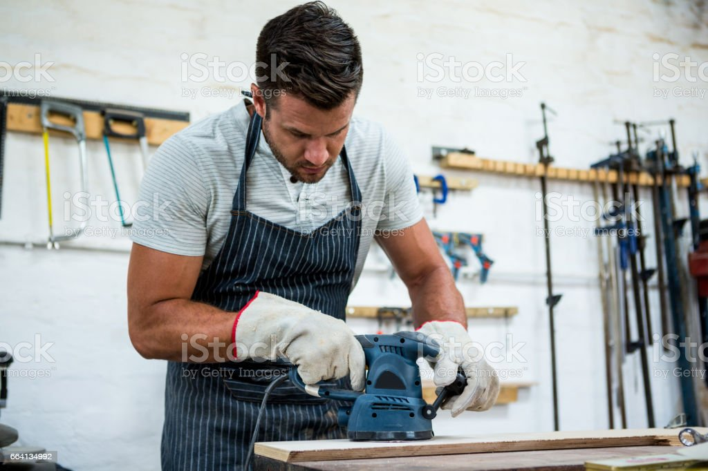 Carpenter working on his craft foto stock royalty-free