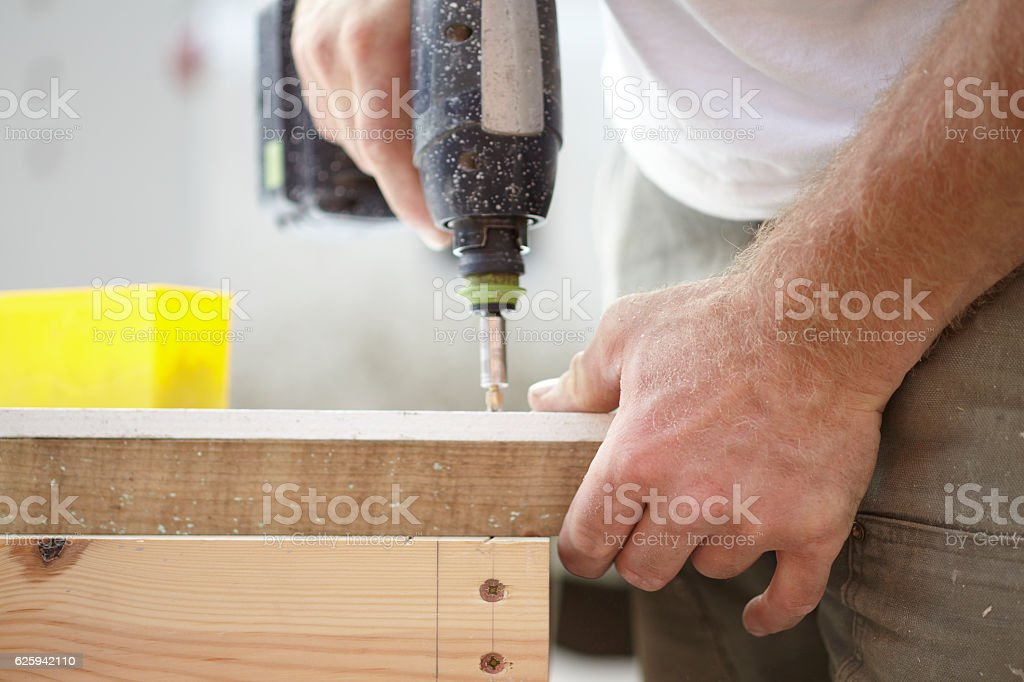 Carpenter Working With Cordless Drill stock photo