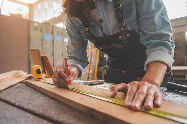Carpenter working with equipment on wooden table in carpentry shop. woman works in a carpentry shop. Carpenter working with equipment on wooden table in carpentry shop. woman works in a carpentry shop. craftsperson stock pictures, royalty-free photos & images