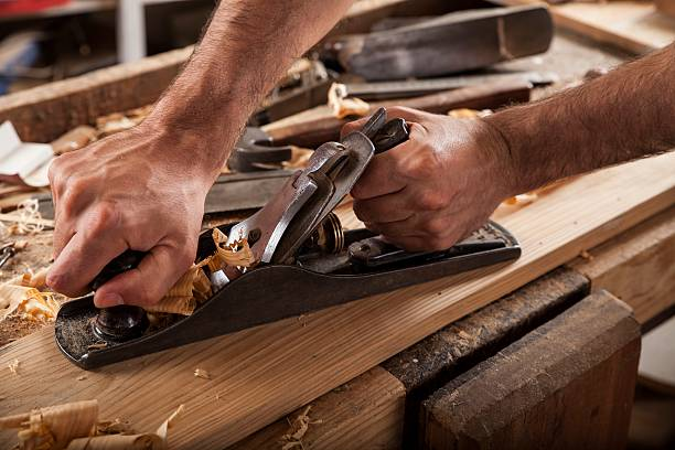 carpenter working with plane on wooden background – Foto
