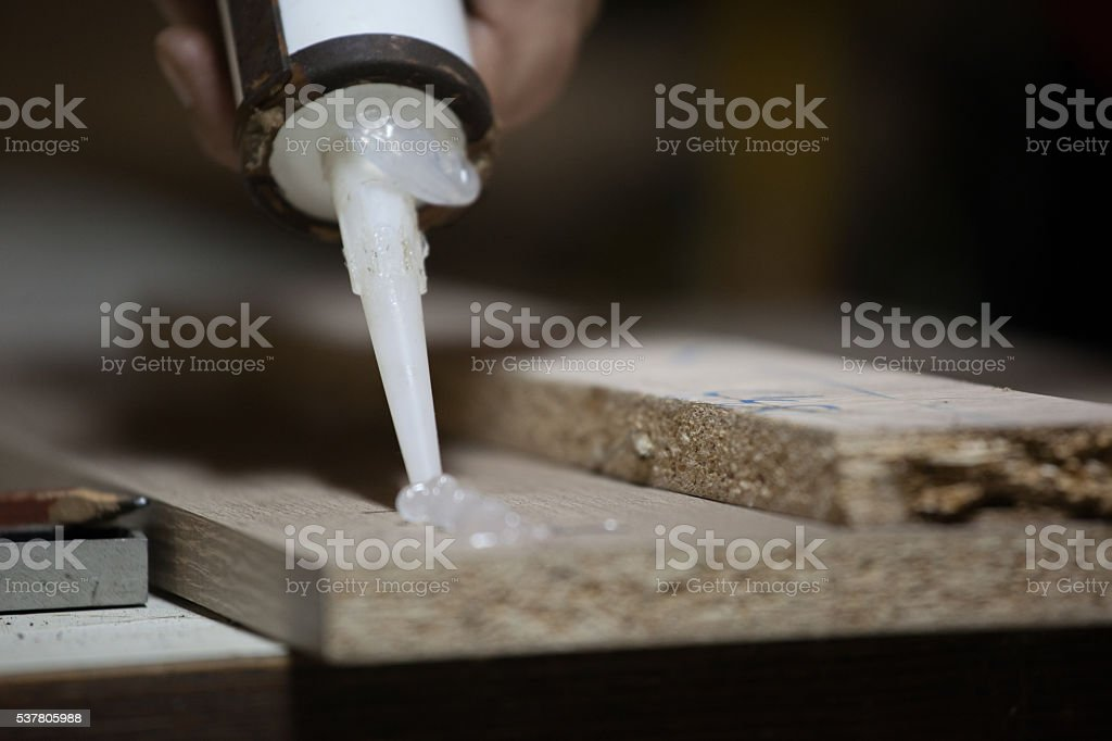 Carpenter working with silicon stock photo