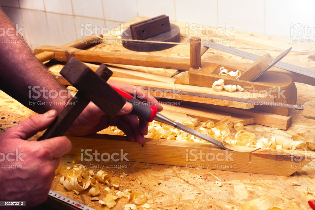 carpenter working,hammer,meter and screw-driver on construction stock photo