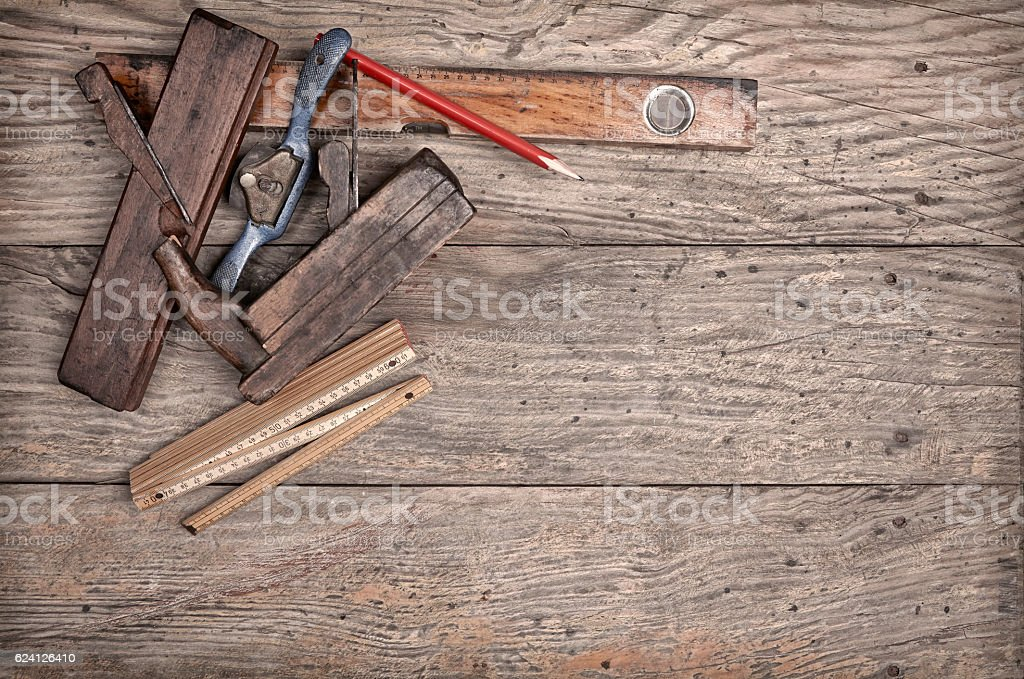 Carpenter'€™s hand tools on a wooden background stock photo