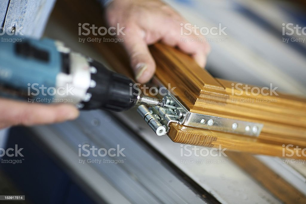 Carpenters hands making window stock photo