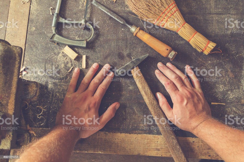 Carpenter's little working tools on a dusty table. royalty-free stock photo