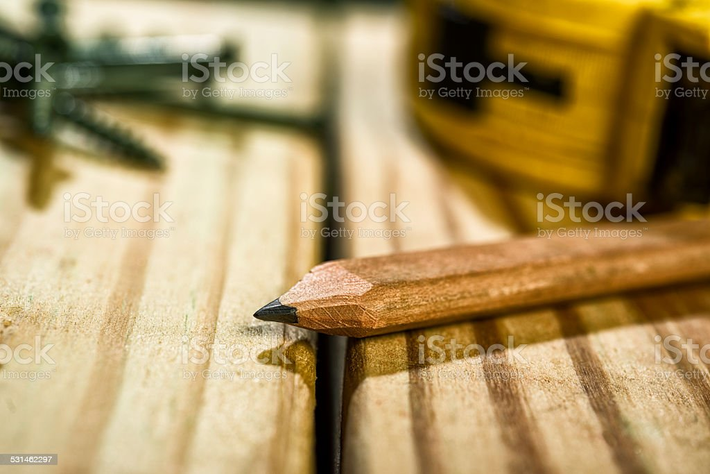 Carpenter's Pencil and Measureing Tape sitting on a wood deck stock photo