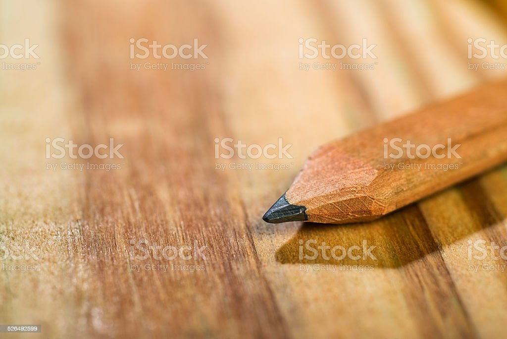 Carpenter's Pencil sitting on a wood deck stock photo