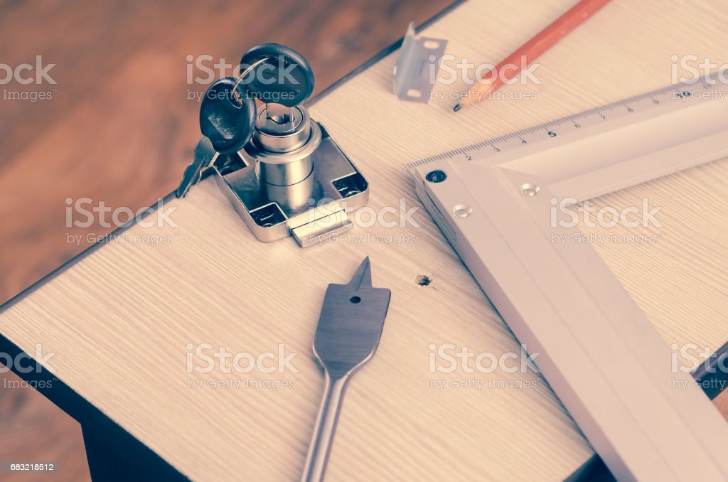 Carpenter's pencil, square, drill feather and mortise lock 免版稅 stock photo