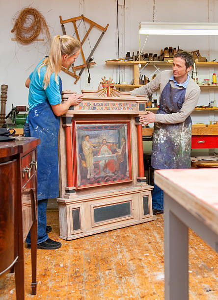 carpenters restoring antique art - curator stock pictures, royalty-free photos & images