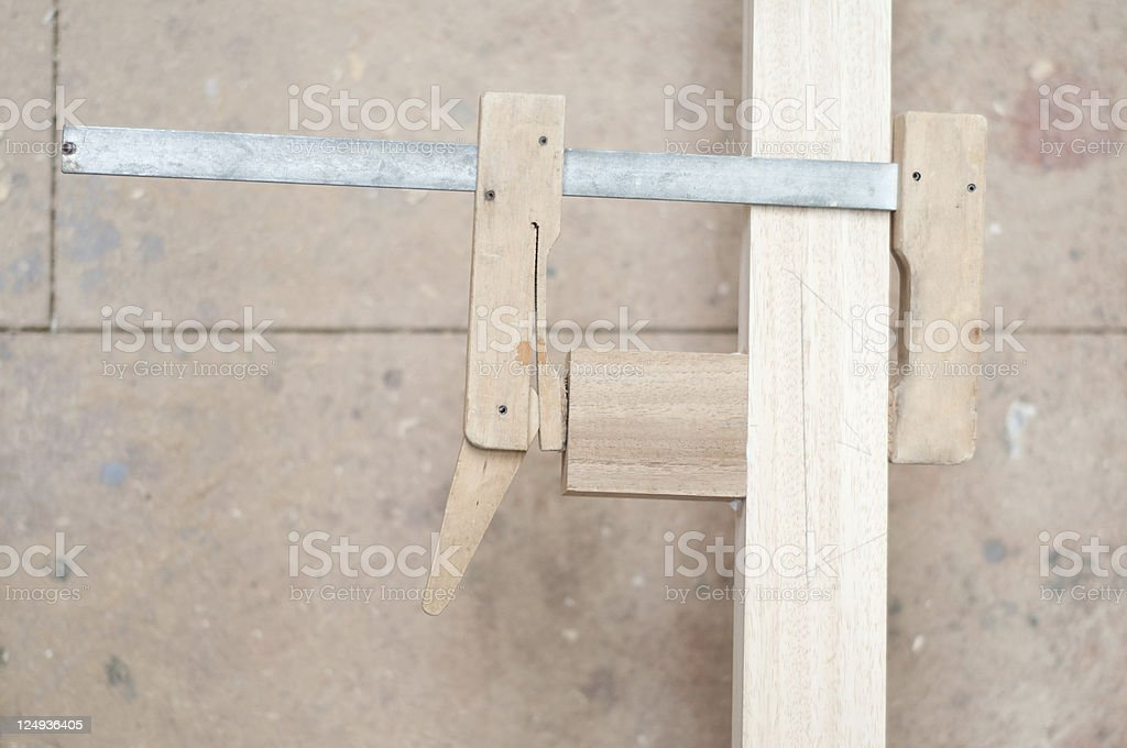 Carpenter's shop, clamp holding timber together, selective focus royalty-free stock photo