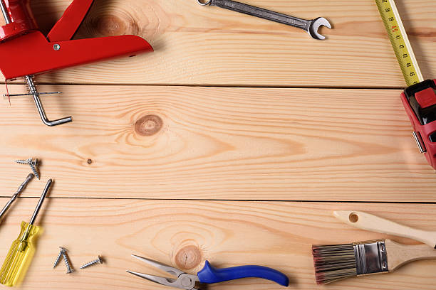 Carpentry, handyman tools on wooden planks. Carpentry, construction hardware tools on wooden planks. Top view, copy space. knolling concept stock pictures, royalty-free photos & images
