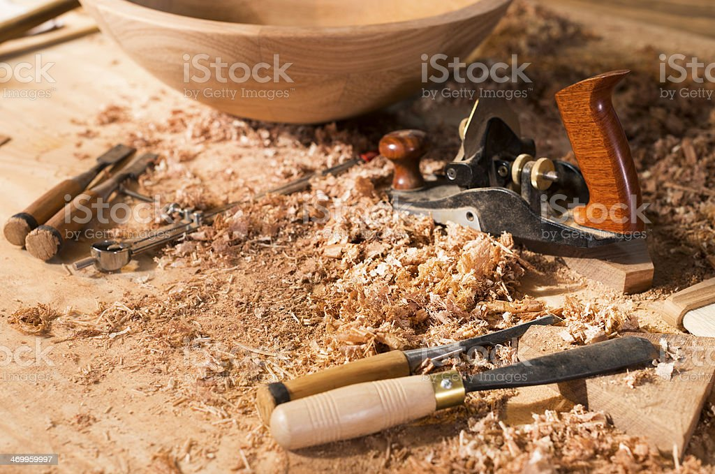 Carpentry Manufacture Workshop. Wooden Bowl. Tools. Chisel. Saw. royalty-free stock photo