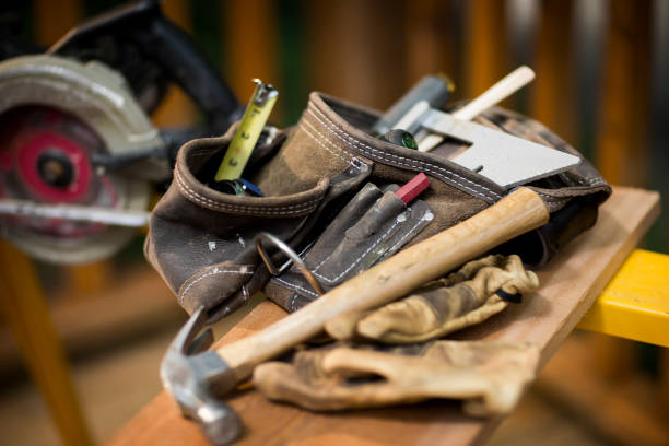 carpentry tools on wooden plank. - tool belt stock photos and pictures