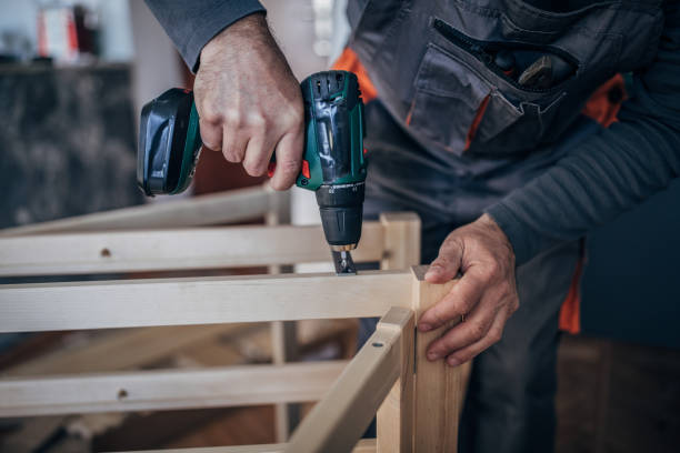 Carpentry - Using A Cordless Drill Carpentry - Using A Cordless Drill cordless phone stock pictures, royalty-free photos & images