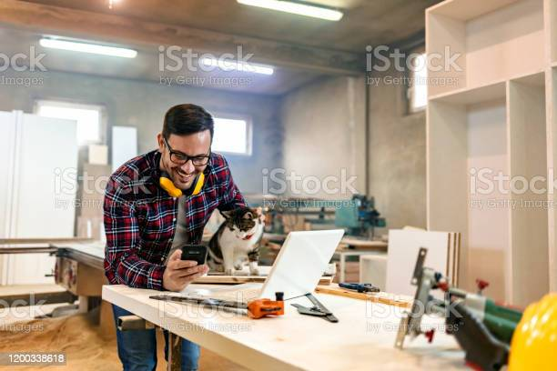 Carpentry workshop owner works on laptop picture id1200338618?b=1&k=6&m=1200338618&s=612x612&h=coyykjb3rqh7jvehuc7euwmjmrbo5wgy9ak6d0ha9c8=