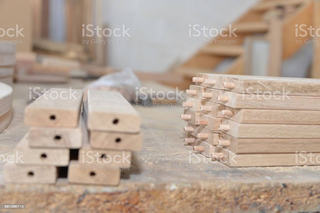Carpentry workshop table and billets of wood for chair. royalty-free stock photo