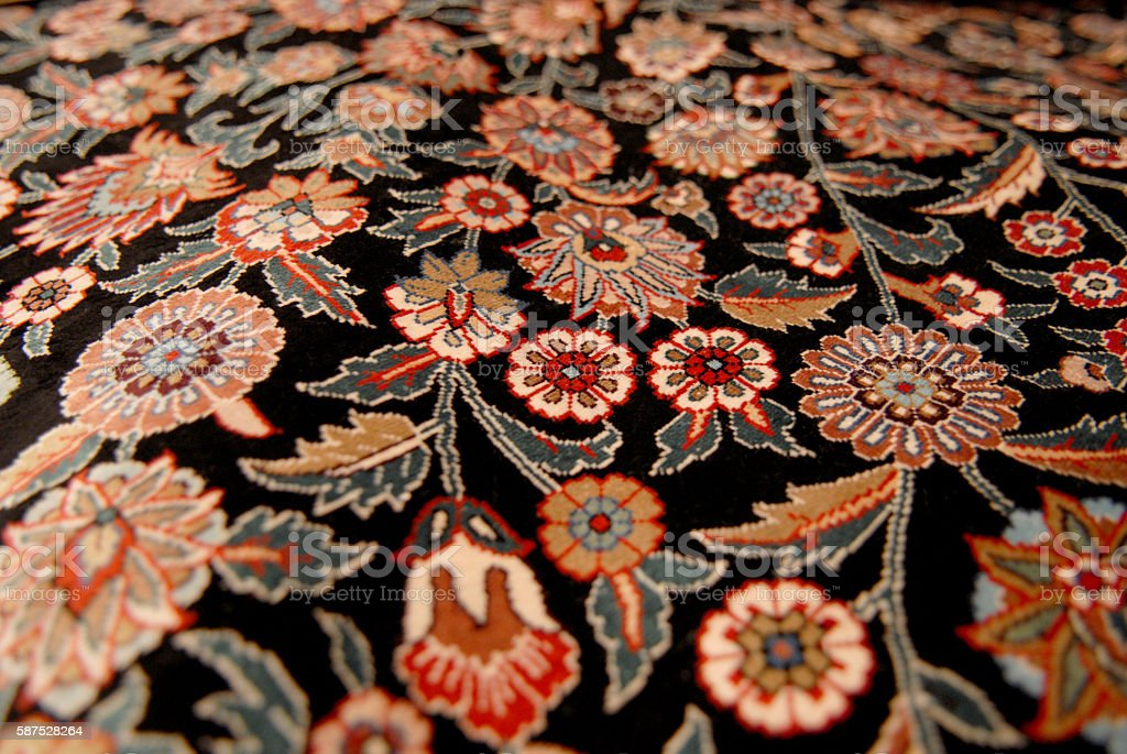 carpet decorated with flowers stock photo