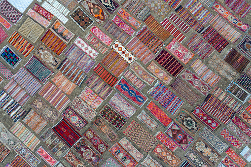 Aerial view of colourful carpets  under sunlight for accelerated ageing. Taken via drone