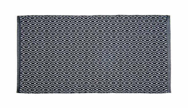teppich isoliert auf weißem hintergrund - teppich baumwolle stock-fotos und bilder