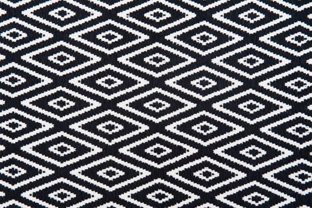 teppich auf weiß isoliert - teppich geometrisch stock-fotos und bilder