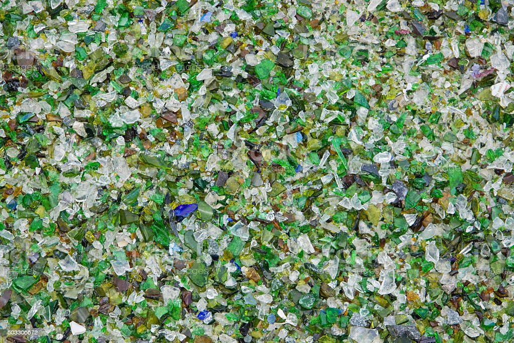 Carpet of crushed glass particles at a recycling plant UK stock photo