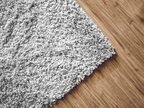 carpet on parquet stock photo