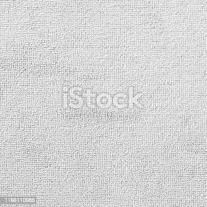 Carpet or white beach towel texture background in beige color made of wool or synthetic fibers, polypropylene, nylon or polyester material