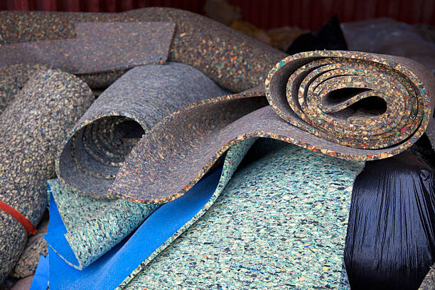 Carpet padding Load of carpet paddings to be recycled. padding stock pictures, royalty-free photos & images
