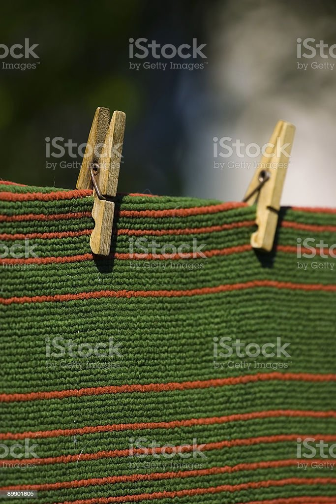 carpet pegged to a clothesline royalty-free stock photo