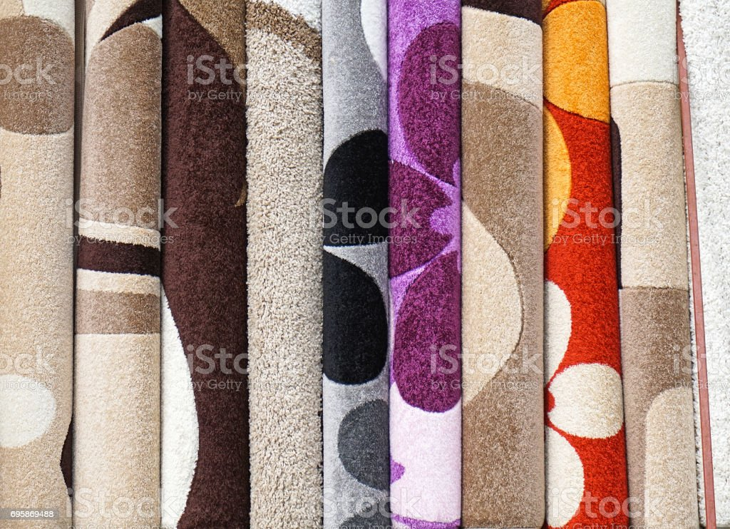 Carpet rolls in a row stock photo