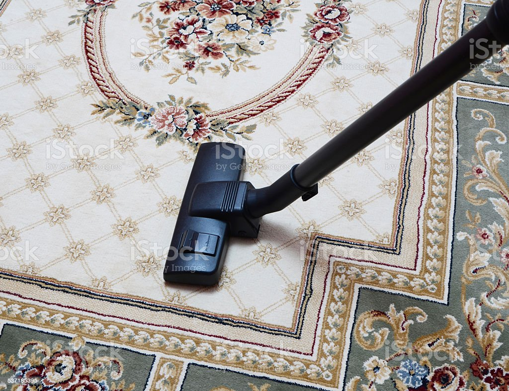 carpet vacuuming with vacuum cleaner at home