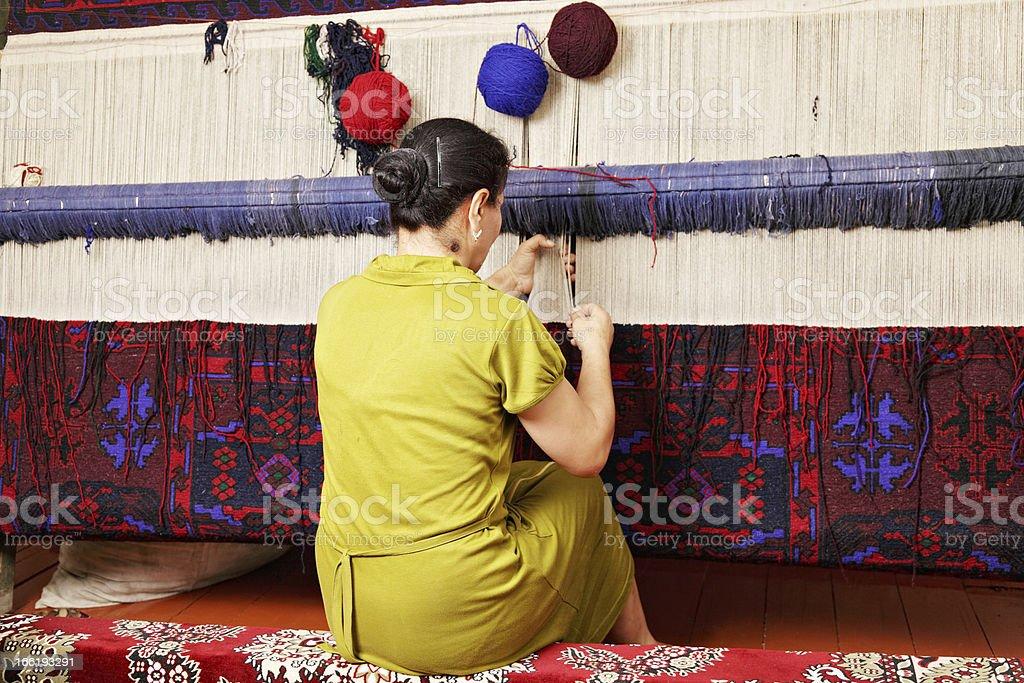 Carpet weaver stock photo