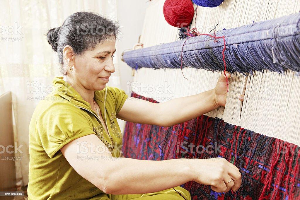 Carpet weaver sideview closeup stock photo