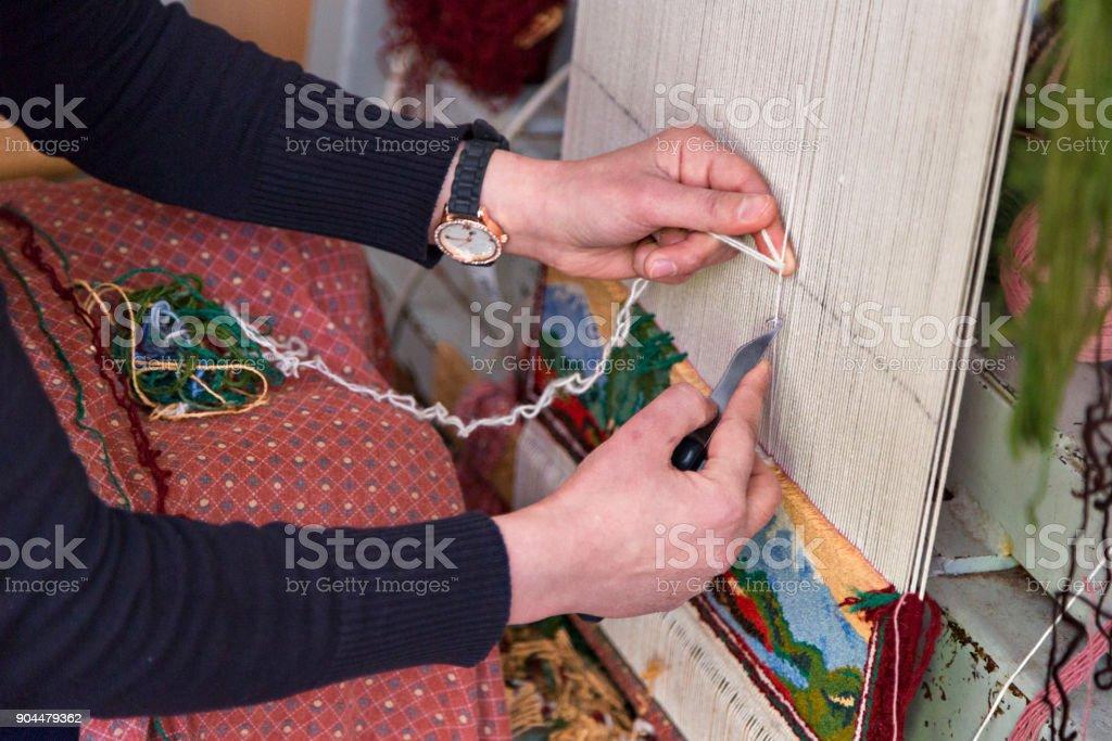 Carpet weaving in Armenia. stock photo