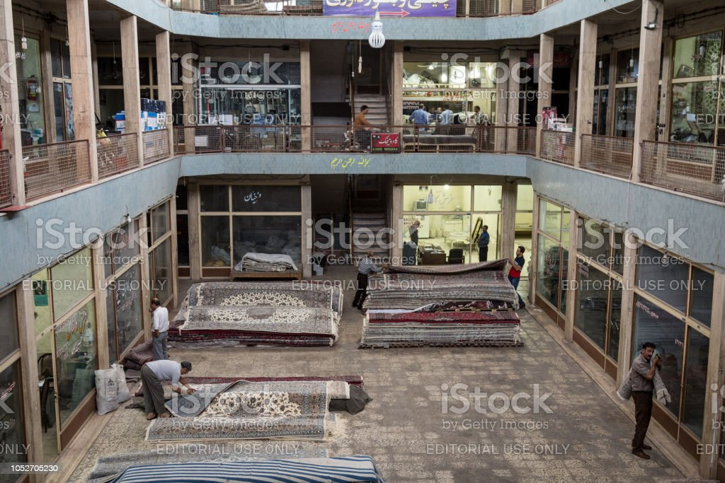 Carpets for sale in the rug district of the Kashan Bazaar. Carpets and Rugs are one of the symbols of Persian culture. Kashan is one of the main cities of central Iran stock photo