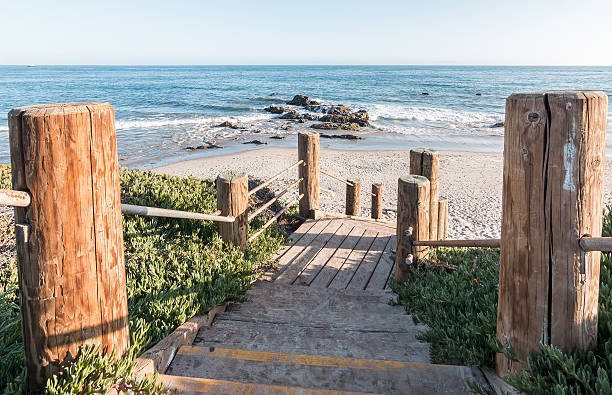 Carpinteria Coast Stairs Stairs leading down to the beach and Pacific ocean at Carpinteria State Beach, California. santa barbara california stock pictures, royalty-free photos & images