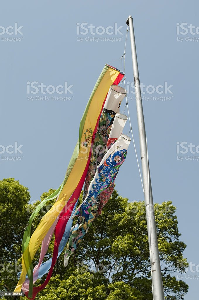 Carp-shaped streamers against blue sky royalty-free stock photo