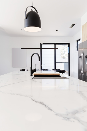 Carrera marble benchtop with black goose neck kitchen tap