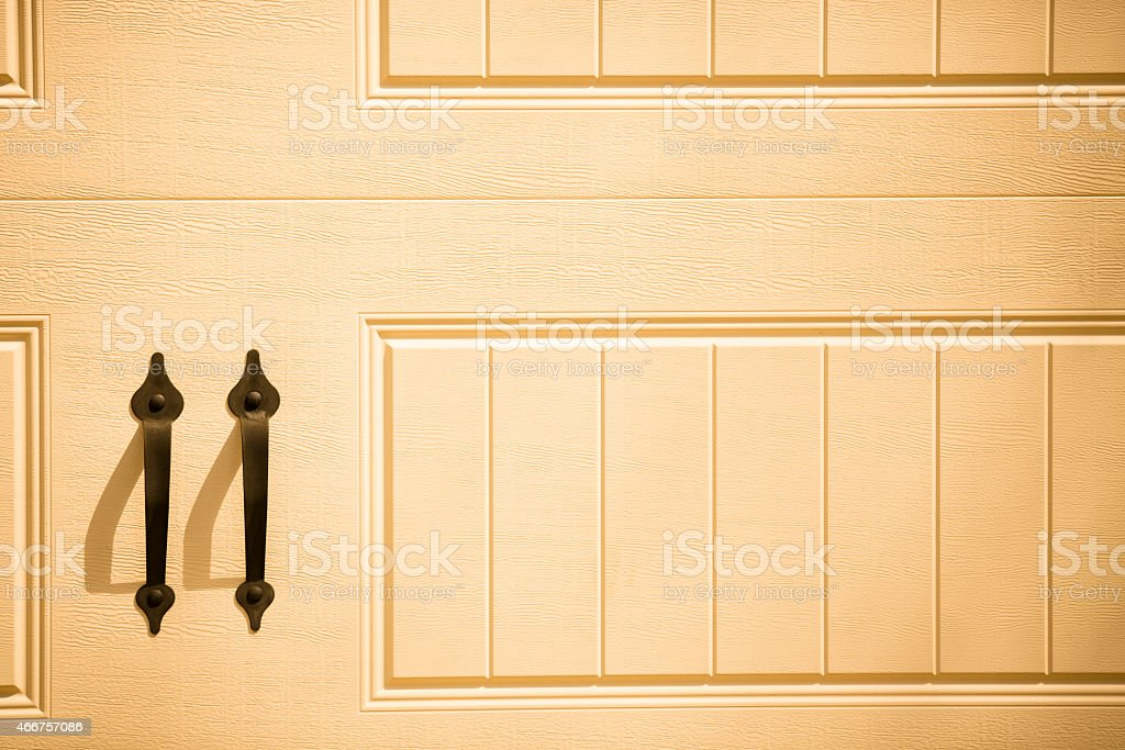 Carriage house style garage door close-up. Handles. stock photo
