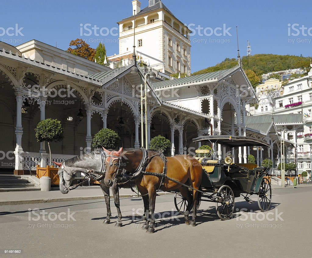 carriage in front of a pump room Karlovy Vary Karlsbad royalty-free stock photo