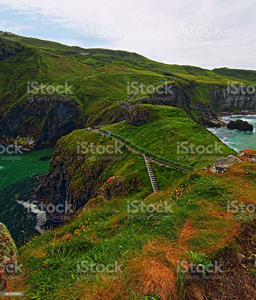 Carrick-a-Rede Irish Coastal Island with walking paths and suspension bridge stock photo