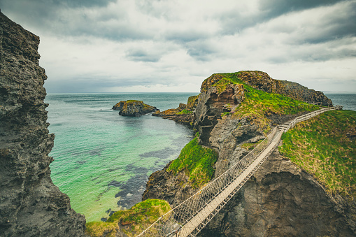 istock carrick-a-rede rope bridge, northern ireland 959312202