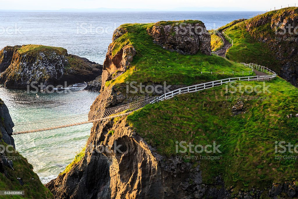 Carrick-A-Rede Rope in Northern Ireland The old bridge over 200 years which can operate nowadays, situate in Northern Ireland. Agricultural Field Stock Photo
