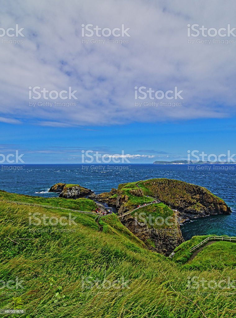 Carrick-a-Rede suspension bridge tiny Irish Coastal Island stock photo