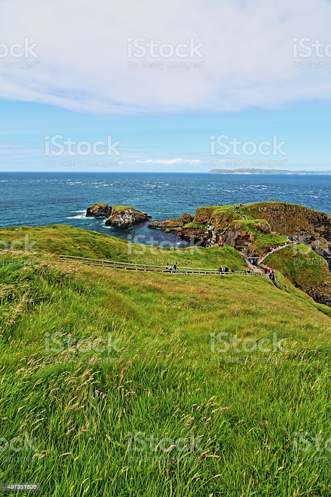 Carrick-a-Rede tiny Irish Coastal Island - grassy bluff overlooking stock photo